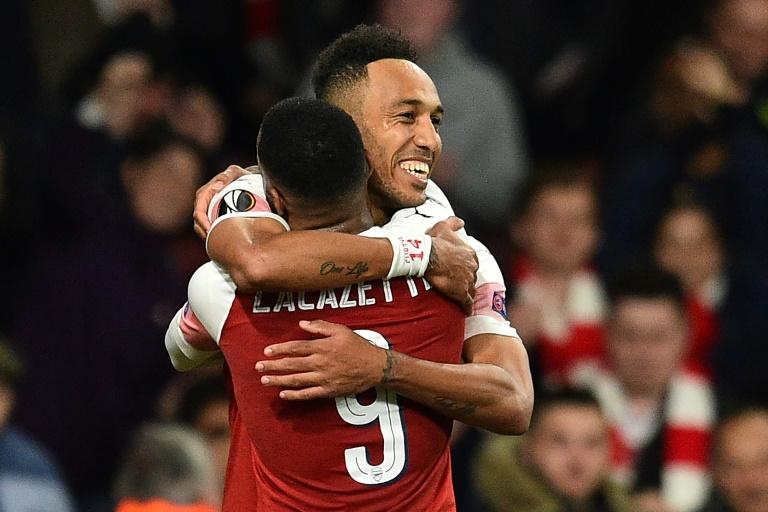 0899cfd38 Pierre-Emerick Aubameyang celebrates with Alexandre Lacazette after scoring  against Valencia in the semi-finals