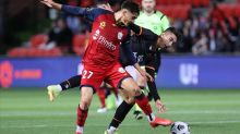 Reds grind out A-League win over Brisbane