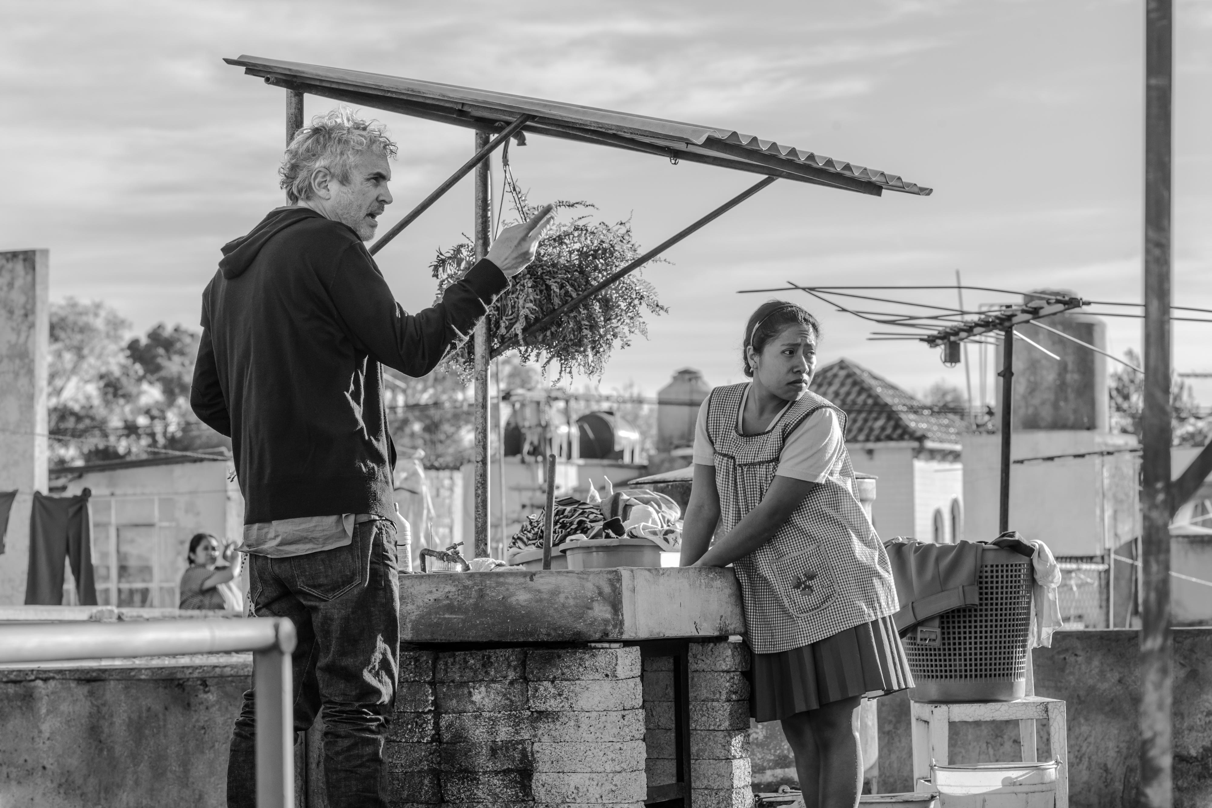 """This image released by Netflix shows filmmaker Alfonso Cuaron on the set of """"Roma."""" The Mexican film academy announced Friday that it has chosen """"Roma"""", by Academy Award-winner Alfonso Cuaron, as its bid for a best foreign language film nomination. (Carlos Somonte/Netflix via AP)"""