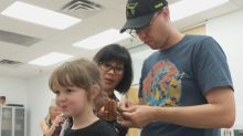 Edmonton crash course gives dads brush up on styling their daughters' hair