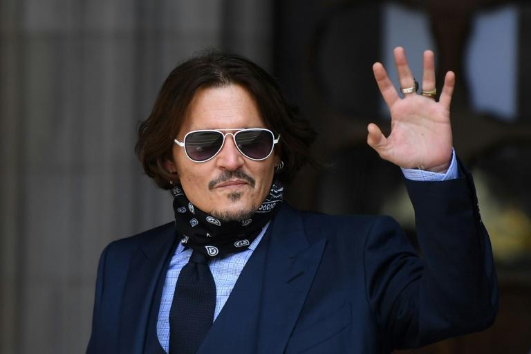 A bodyguard of US actor Johnny Depp testified that he had never seen Depp hit ex-wife Amber Heard (AFP Photo/DANIEL LEAL-OLIVAS)