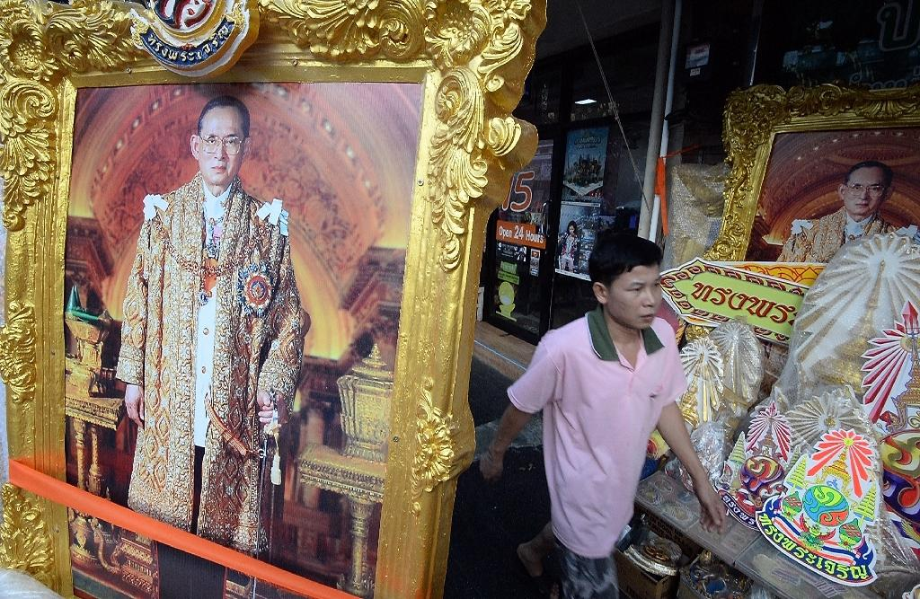 King Bhumibol, 88, is the world's longest-serving monarch and is widely revered in Thailand where his economic and social teachings are extensively promoted (AFP Photo/Indranil Mukherjee)