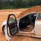 Man arrested for using tractor to dump soil on girlfriend in car