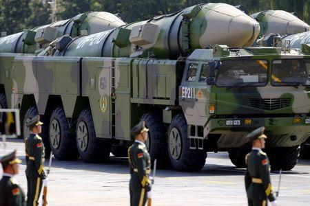 Military vehicles carrying DF-21D ballistic missiles roll to Tiananmen Square during a military parade to mark the 70th anniversary of the end of World War Two, in Beijing, China, September 3, 2015. REUTERS/Damir Sagolj/Files
