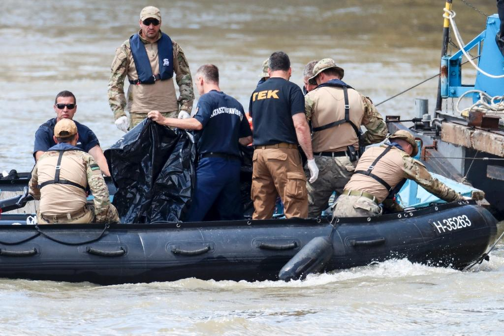 International divers and experts are assessing ways of hoisting the submerged boat or searching for bodies presumed to be stuck inside