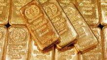 Gold advances on technical buying, light safe haven demand