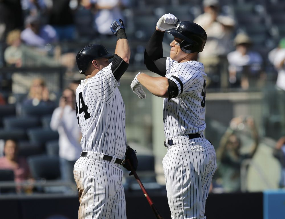 New York Yankees' Aaron Judge, right, celebrates homer with teammate Gary Sanchez (AP)