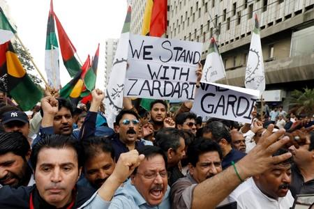 Supporters of political party Pakistan People's Party (PPP)carrying signs and flags chant slogans during a protest in Karachi