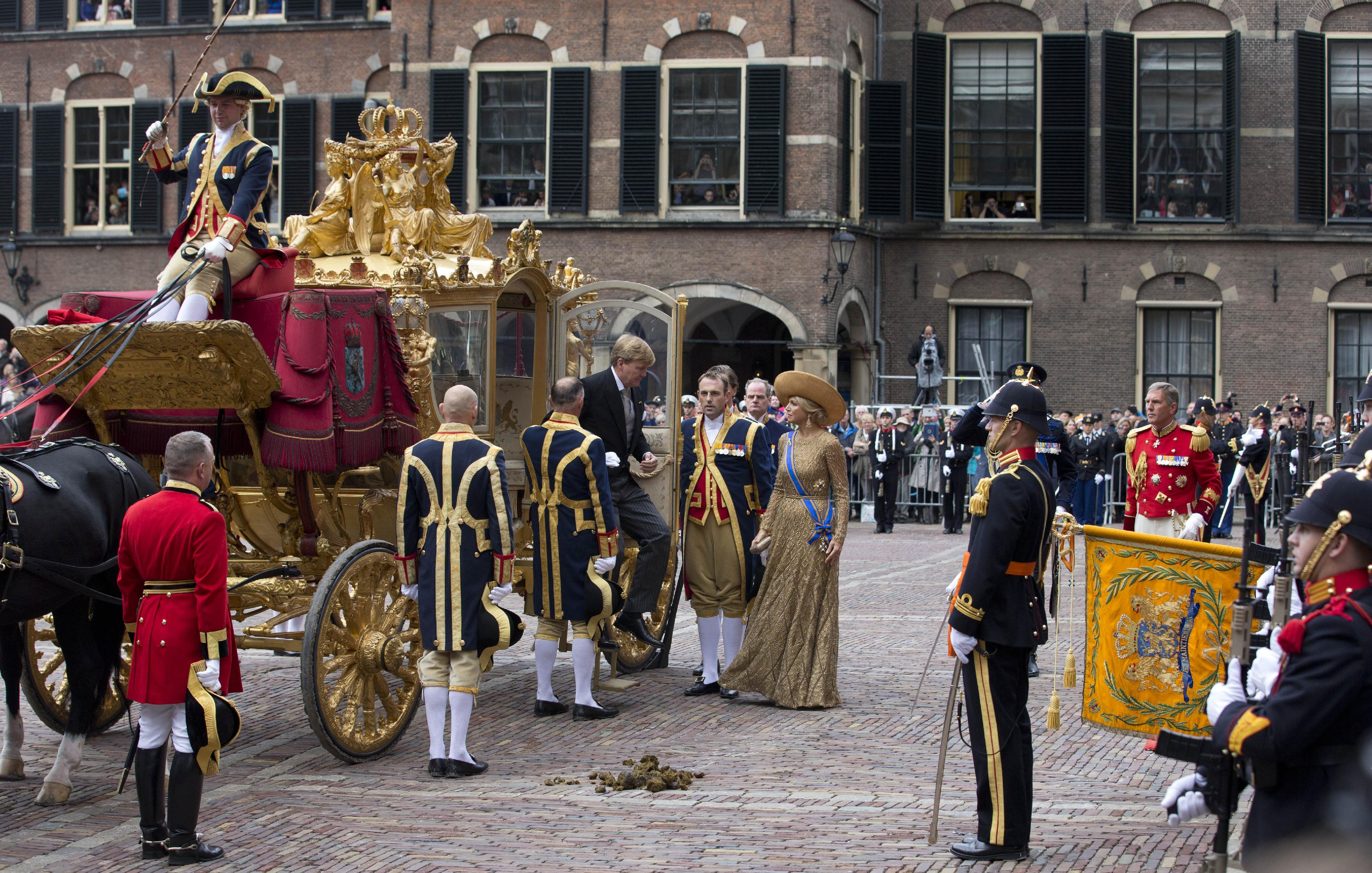 Netherlands' King Willem-Alexander, center left, and his wife Queen Maxima, center right, arrive at the Hall of Knights for the officially opening of the new parliamentary year with a speech outlining the government's plan and budget policies for the year ahead in The Hague, Netherlands, Tuesday, Sept. 17, 2013. (AP Photo/Peter Dejong)