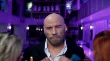 John Travolta is the surprise secret star of Pitbull's new music video