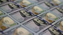 Dollar steady near 2-week high in quiet Good Friday trading