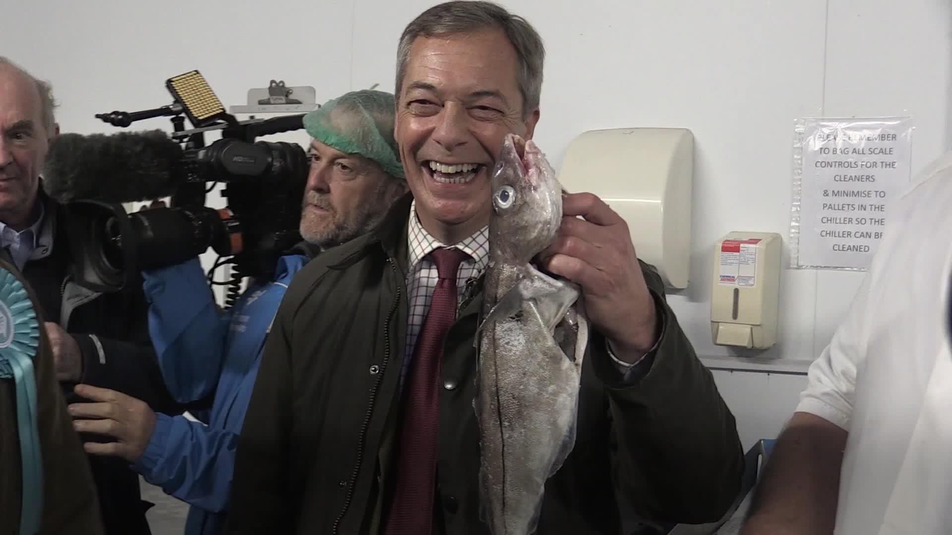Farage poses with fish during Grimsby election campaign stop - Yahoo News UK
