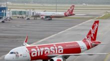 Malaysia's AirAsia founders not taking salary; staff accepts up to 75% pay cut