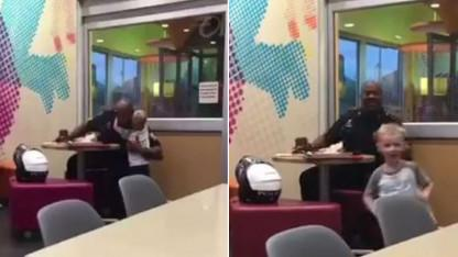 Shy 3-Year-Old Wraps Police Officer in Bear Hug in Video That's Gone Viral