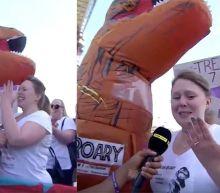 Giant inflatable T-rex pops the question during London marathon