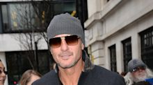 Tim McGraw says he will cut back on workouts after scary collapse