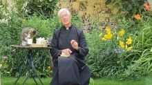 Cat Helps Itself to Some Milk During Dean of Canterbury's Morning Prayer