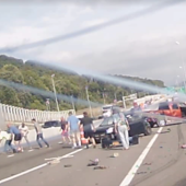 Watch These Heroes Pull a Woman From a Burning Car After a Massive Crash
