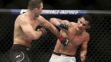 The Latest: Cormier dominates, still UFC 205-pound champ