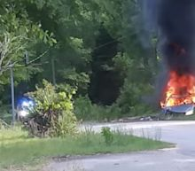 A driver carrying fuel canisters in her car flipped over, setting herself and the car on fire - another hoarding accident since the Colonial Pipeline was taken out