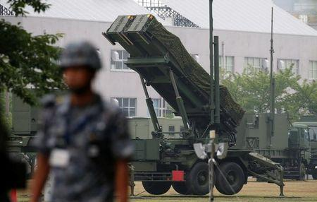 A Japan Self-Defense Forces soldier guards near a unit of PAC-3 missiles at the Defense Ministry in Tokyo