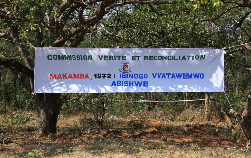 A banner hangs to identify the site of a 1972 mass grave in the Gikuzi village, Makamba Province