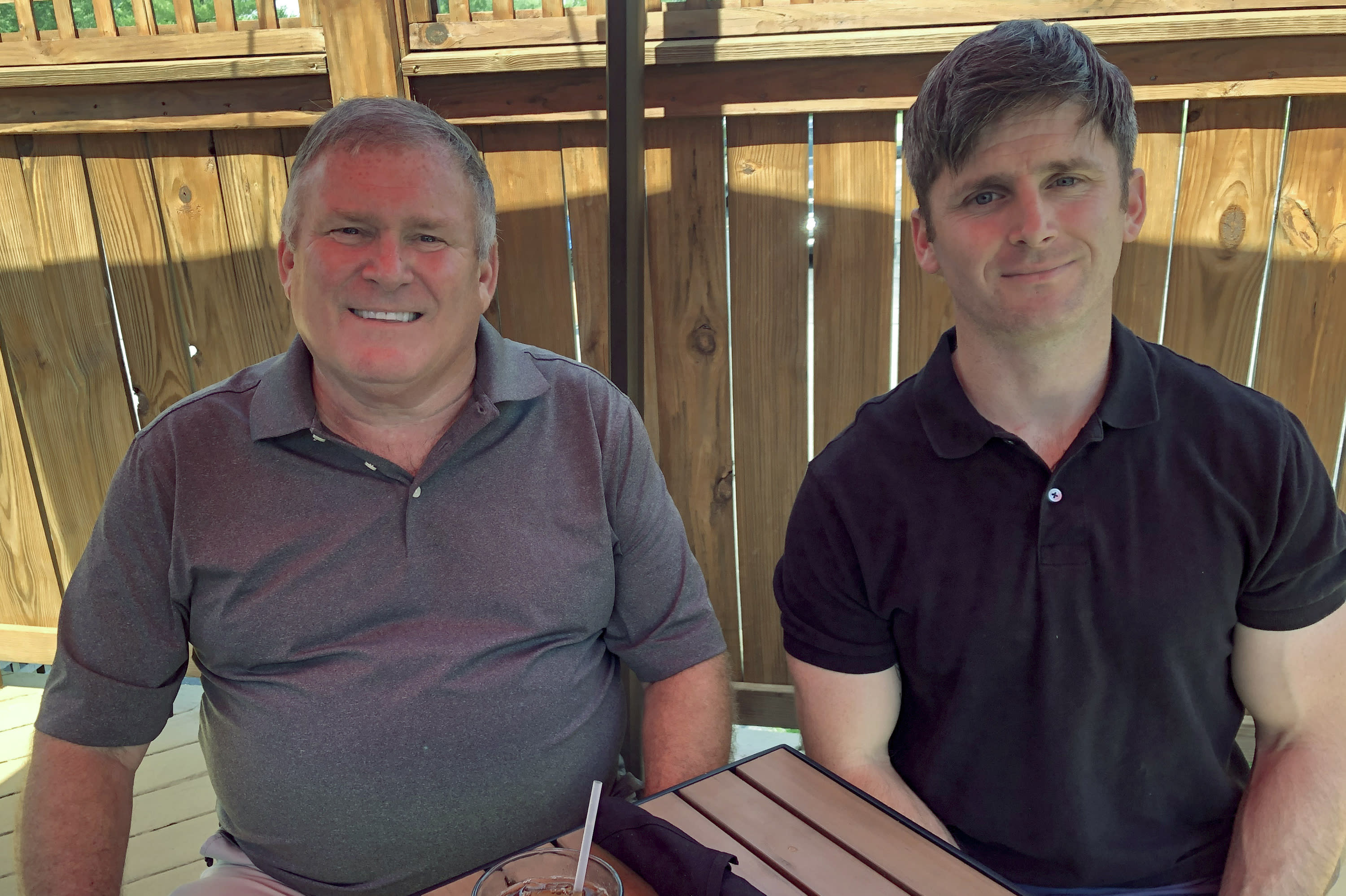 This photo from June 26, 2020 shows Buck Newsome, left, a Baby Boomer, and his son, Chris Newsome, of the Millennial generation, as they pose for a photo while having lunch together in Newtown, Ohio. American's two largest generations can agree on something: the coronavirus pandemic has hit them both hard. For Baby Boomers, named for the post-World War II surge of births, that means those who retired or are nearing retirement age are seeing their retirement accounts in a free fall. Millennials, usually defined as those born between 1981 and 1996, who became adults in this century, are getting socked as they were trying to begin careers or moving into peak earning years after many walked off college campuses into the Great Recession. (AP Photo/Dan Sewell)