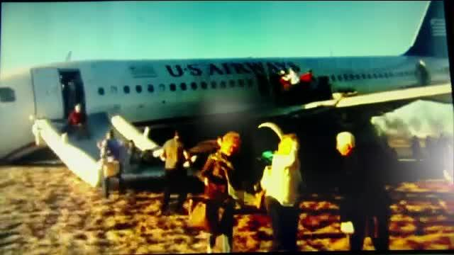 US Airways plane blows tire, crashes nose-first