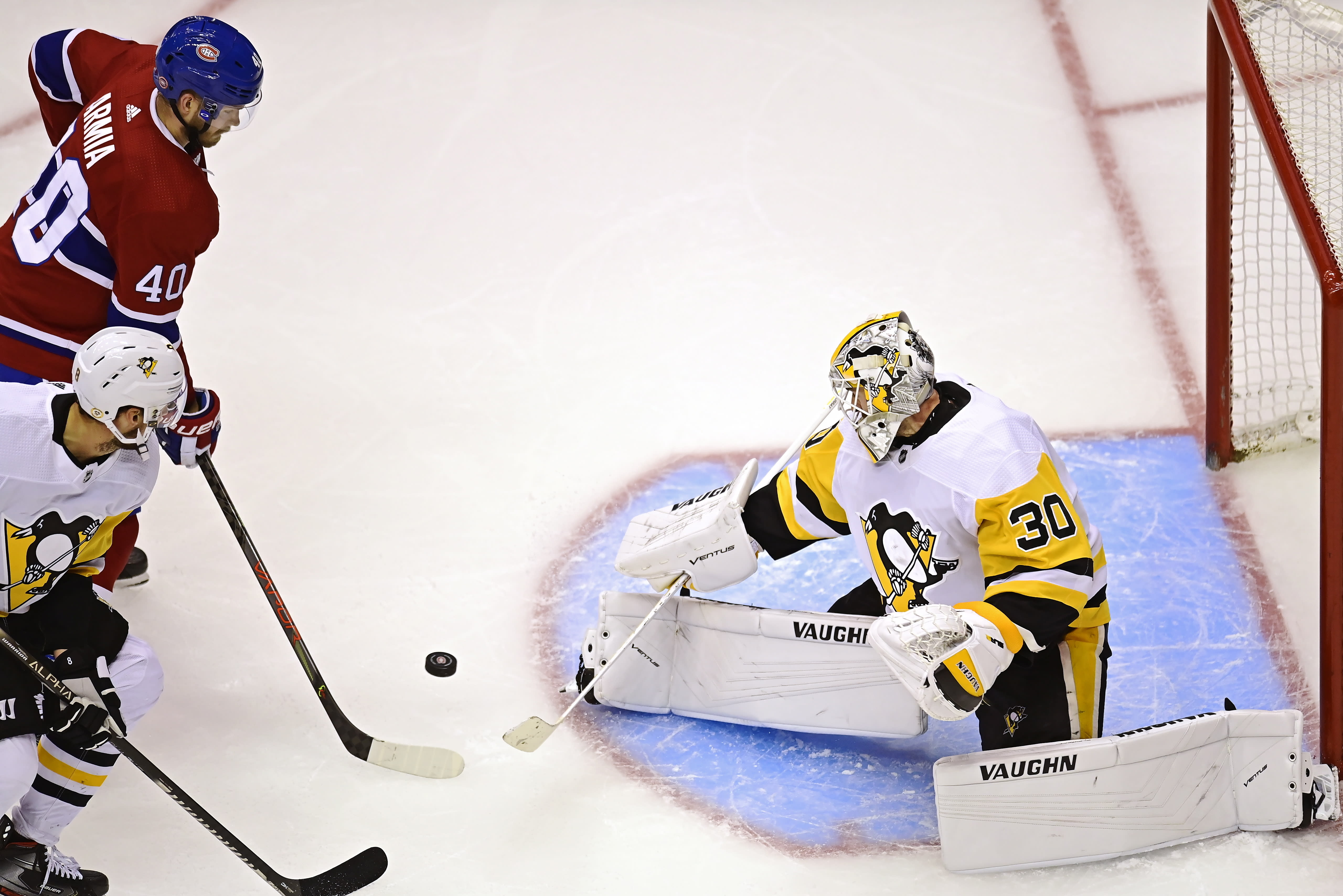 Pittsburgh Penguins goaltender Matt Murray (30) makes a save on Montreal Canadiens' Joel Armia (40) during the second period of an NHL hockey playoff game Wednesday, Aug. 5, 2020 in Toronto. (Frank Gunn/The Canadian Press via AP)