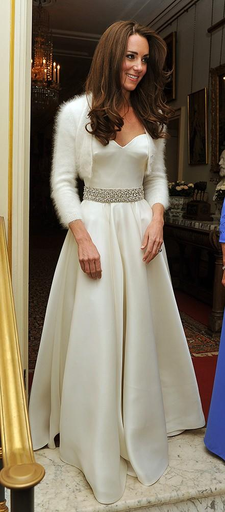 Kate leaving Clarence House to attend the evening celebrations following her wedding to Prince William, in a pretty satin dress with an embellished belt showing off her tiny waist.