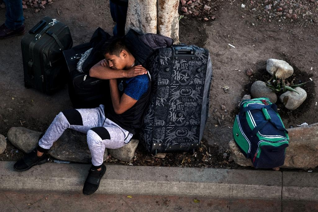 An asylum seeker in Tijuana, Baja California state, Mexico, rests while waiting his turn to present himself to US border authorities and request asylum, in April 2019