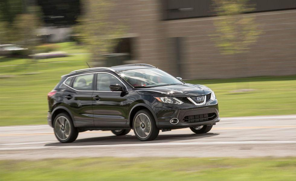 """<p><strong>MSRP:</strong> $23,385 <strong> Engine:</strong> 2.0-liter inline-4 <strong>EPA Combined:</strong> 28 mpg</p><p>The <a href=""""https://www.caranddriver.com/nissan/rogue-sport-2019"""" rel=""""nofollow noopener"""" target=""""_blank"""" data-ylk=""""slk:Rogue Sport"""" class=""""link rapid-noclick-resp"""">Rogue Sport</a> is a stylish and comfortable compact SUV with class-competitive passenger and cargo room. Despite its name, it's not in the least sporty to drive. (The """"Sport"""" badge distinguishes it from its larger Rogue sibling.) Still, its strong fuel economy and an asking price on the low side notched it into second place in this cheap-to-own guide.</p>"""
