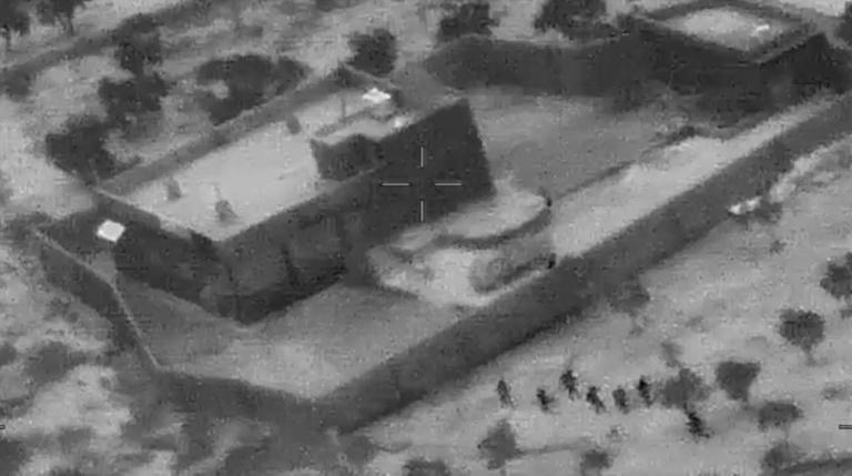 This still image from a video released by the US Department of Defense shows US forces (lower R) advancing on the compound of Islamic State group leader Abu Bakr al-Baghdadi in Syria (AFP Photo/Jose ROMERO)