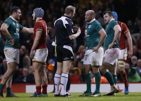 Ireland's Rory Best speaks with referee Wayne Barnes