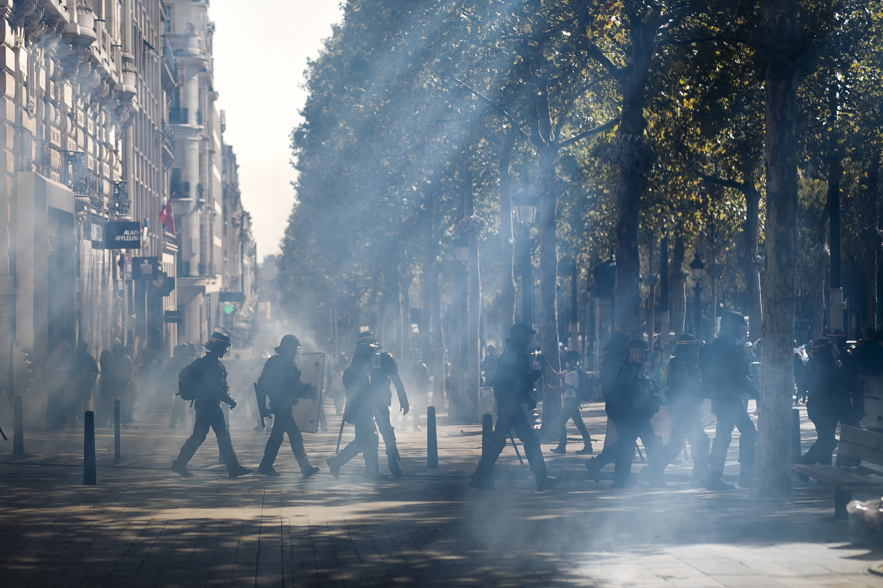 Police use tear gas in Paris amid an array of protests