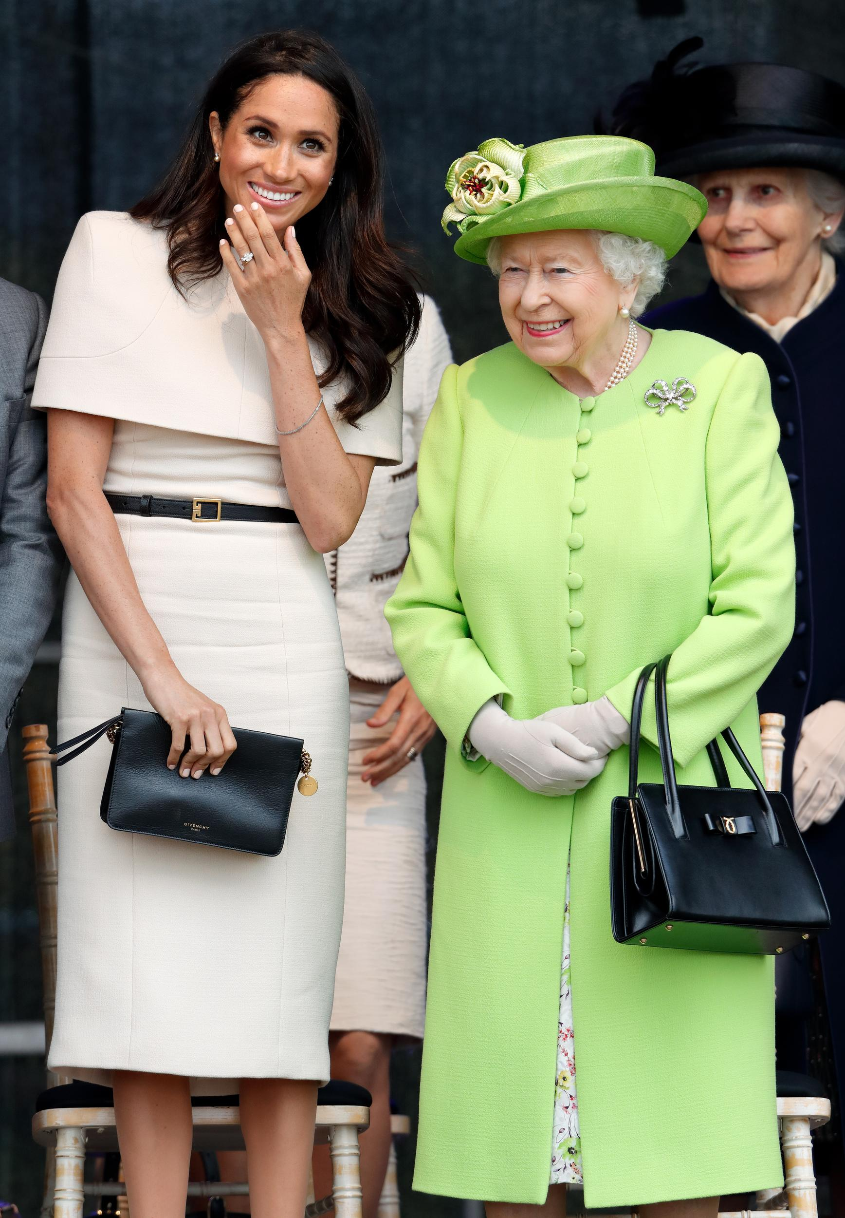 WIDNES, UNITED KINGDOM - JUNE 14: (EMBARGOED FOR PUBLICATION IN UK NEWSPAPERS UNTIL 24 HOURS AFTER CREATE DATE AND TIME) Meghan, Duchess of Sussex and Queen Elizabeth II attend a ceremony to open the new Mersey Gateway Bridge on June 14, 2018 in Widnes, England. Meghan Markle married Prince Harry last month to become The Duchess of Sussex and this is her first engagement with the Queen. During the visit the pair will open a road bridge in Widnes and visit The Storyhouse and Town Hall in Chester. (Photo by Max Mumby/Indigo/Getty Images)