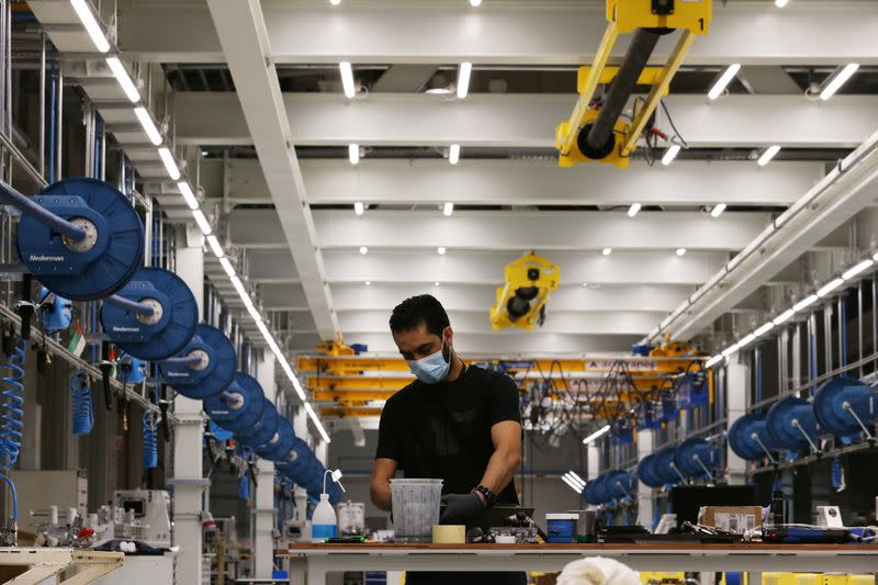 A worker is seen at the Strata Manufacturing facility, in Al Ain
