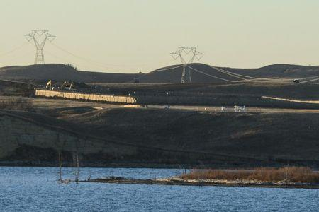 Dakota Access Pipeline equipment is seen near Lake Oahe, near the Standing Rock Indian Reservation, in this picture taken from across the Missouri River in Linton, North Dakota, U.S.