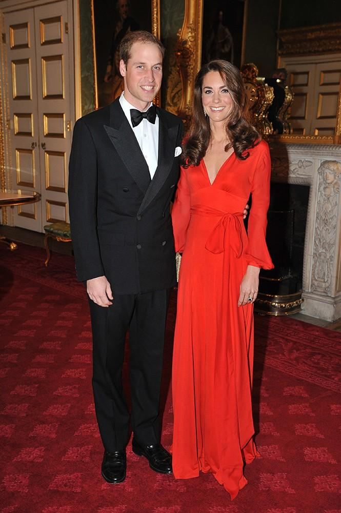 A beautiful duo: Kate wore this crimson Beulah London gown, adding some vibrance to Fall in London.