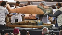 Archaeologists unearthed 210 sarcophagi in an Egyptian city of the dead. They'd remained undisturbed for at least 2,500 years.
