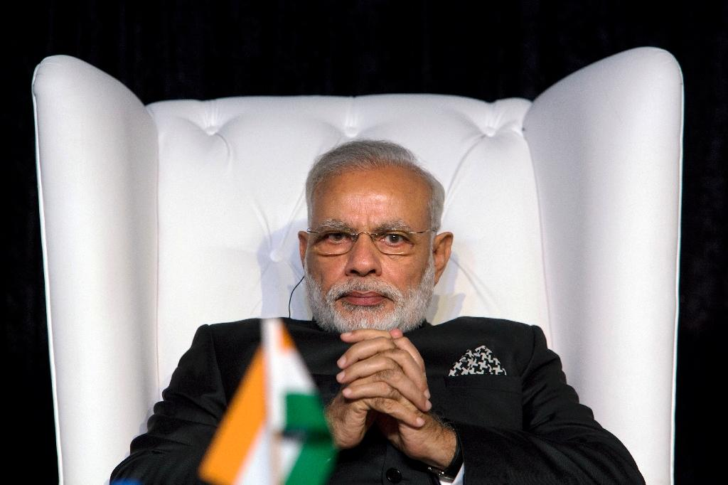 """Prime Minister Narendra Modi held a special midnight session of parliament to launch the new goods and services tax (GST) which he called """"good and simple"""""""