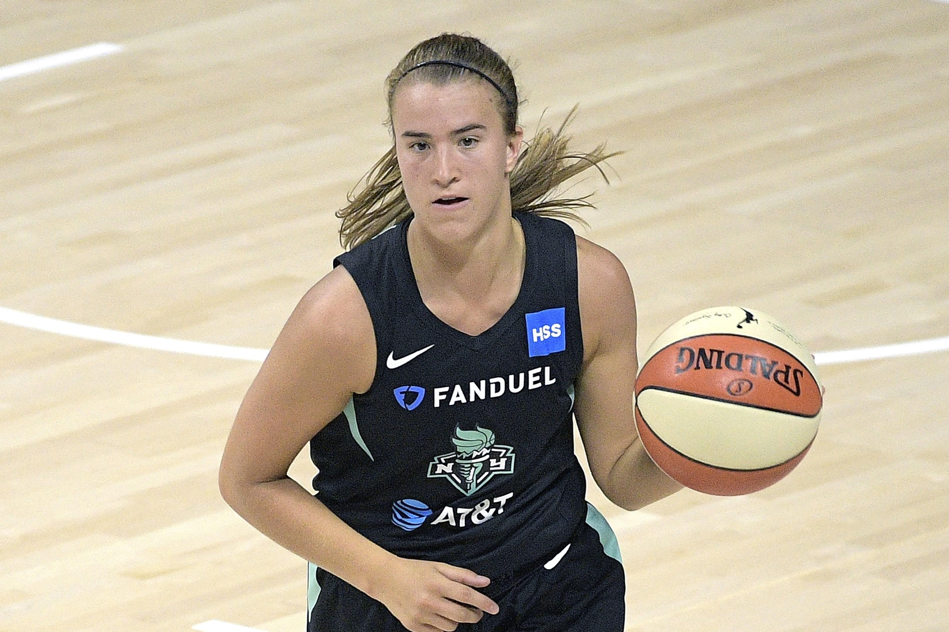 New York Liberty guard Sabrina Ionescu (20) brings the ball up the court during the second half of a WNBA basketball game against the Seattle Storm, Saturday, July 25, 2020, in Bradenton, Fla. (AP Photo/Phelan M. Ebenhack)