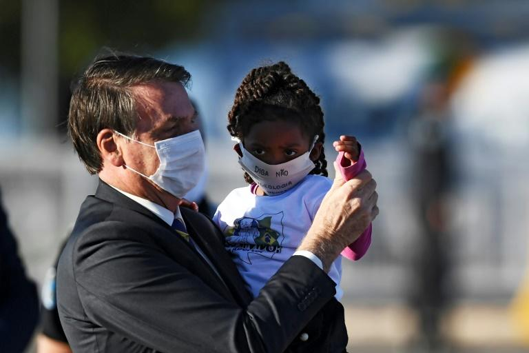 Brazilian President Jair Bolsonaro, pictured in May 2020, has mostly flouted advice to wear a face mask to the delight of many of his supporters (AFP Photo/EVARISTO SA)