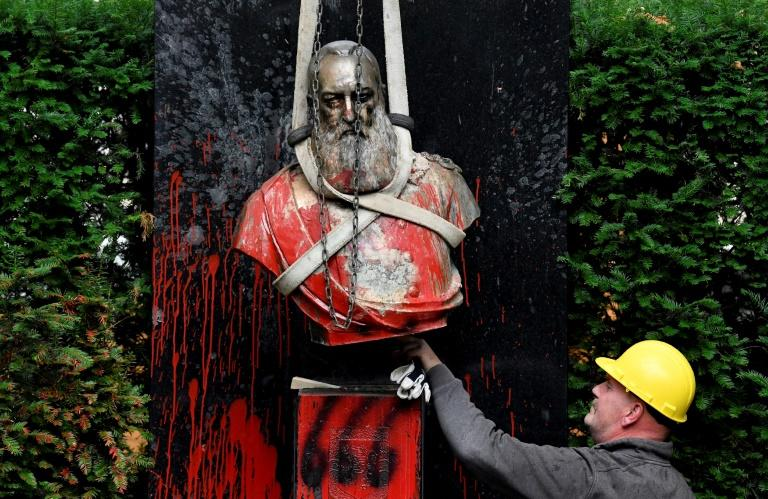 A vandalised statue of King Leopold II of Belgium is removed, in the notorious monarch's home country