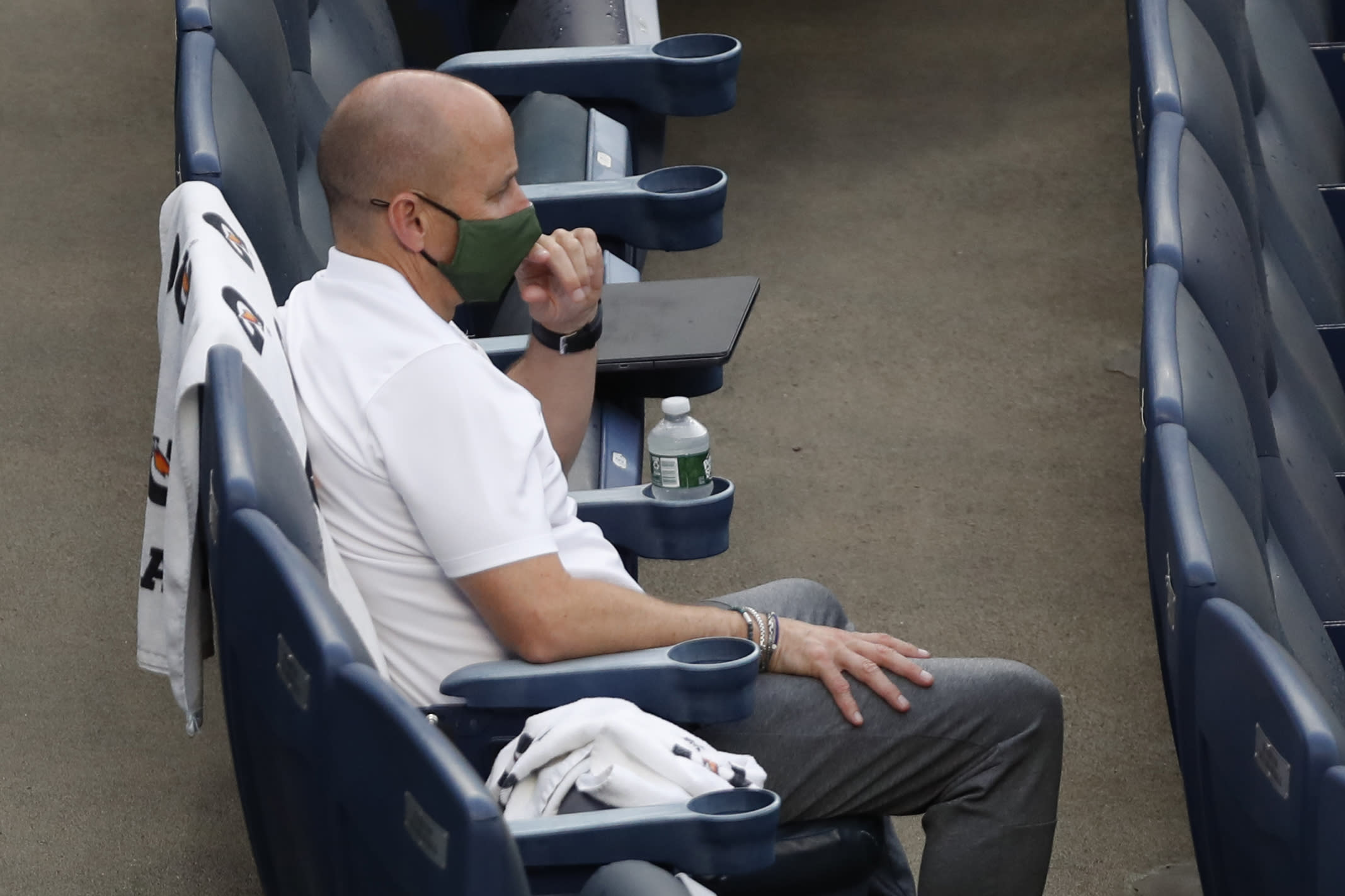 New York Yankees general manager Brian Cashman watches the baseball team's intrasquad game Monday, July 6, 2020, at Yankee Stadium in New York. (AP Photo/Kathy Willens)