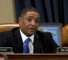 Republicans attack Democratic congressman watching golf during impeachment hearing