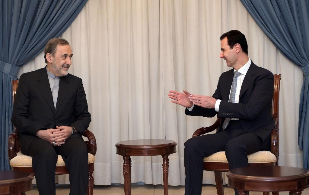 Syrian President Bashar al-Assad (R) meeting with Ali Akbar Velayati, the former Iranian foreign minister and a top adviser to Iran's supreme leader, in the Syrian capital Damascus on May 7, 2016 (AFP Photo/STRINGER)