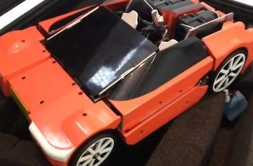 Transforming robot effortlessly turns into a car, faces tougher maneuver into retail (video)