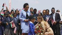 Melania Trump heads to Malawi in a $745 dress as protesters greet her with #MeToo-inspired signs