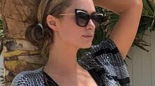 Paris Hilton welcomes summer in a one-piece that shows more skin than a bikini